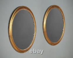 Pair of Large Gilded Oval Wall Mirrors c. 1890