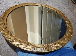 Vintage large round gold ornate floral with leave hanging wall mirror